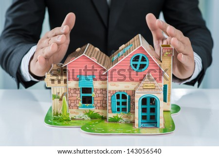 Close-up of a house model on the table inside - stock photo