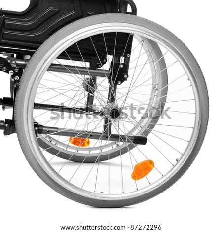Close up of a invalid chair wheel. - stock photo