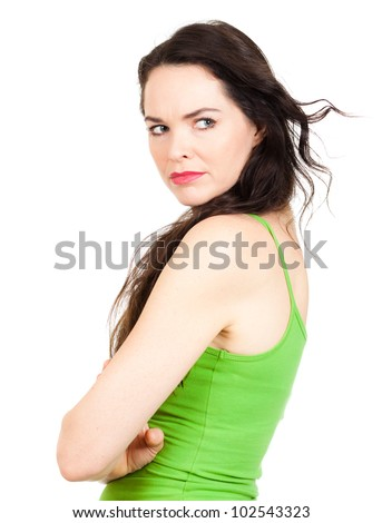 Close-up of a  jealous unhappy beautiful young woman looking over her shoulder at someone. Isolated over white