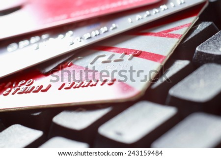 Close-up of a keyboard and credit cards - stock photo
