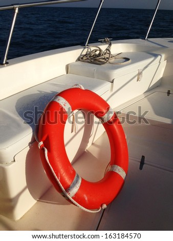 Close up of a lifebelt on a boat at the sunset - stock photo