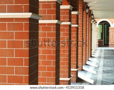Close-up of a line of brick columns. - stock photo