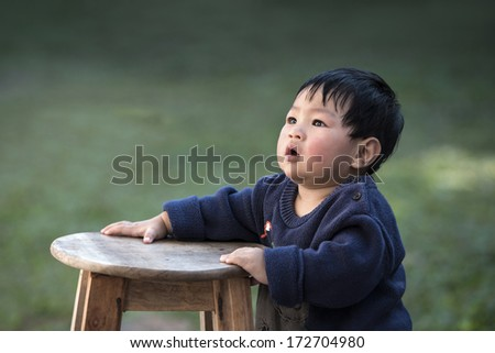 Close up of a little baby boy - stock photo
