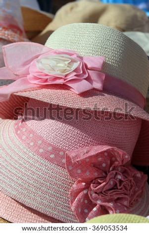 close-up of a lot of different hats of straw in natural light