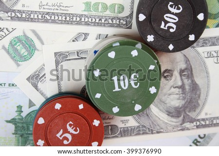 Close-up of a lot of money euro and dollars and casino chips. Casino