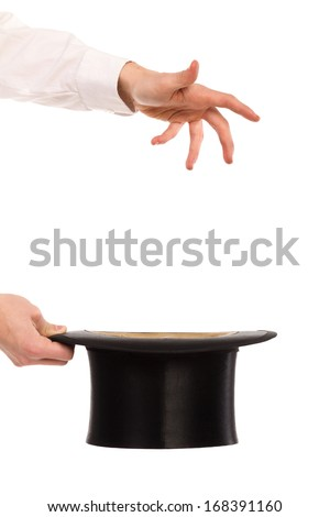 Close up of a magician hands holding top hat and casting a spell. Studio shot isolated on white.