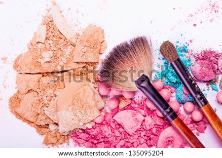 close up of a  make-up accessories -powder, eyeshadow,lipstick - stock photo