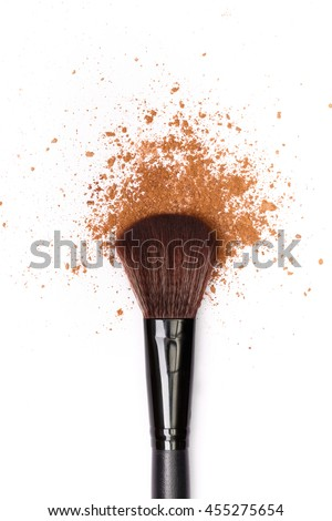 close up of a make up powder and a brush. makeup brush with powder foundation isolated on white - stock photo