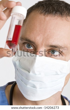 Close up of a  male doctor looking at a blood sample