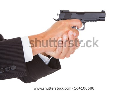 Close-up Of A Male Spy In Suit Holding Handgun