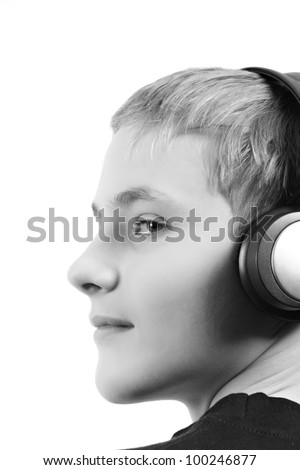 Close-up of a male teenager listening to music with headphone. Isolated on white.