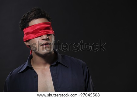 close up of a man blindfolded - stock photo