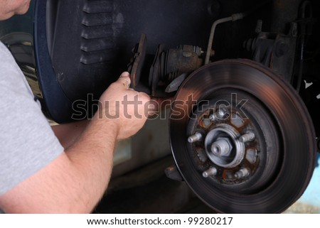 close up of a man checks a brake