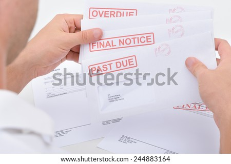 Close-up Of A Man Holding Pending Due Statements - stock photo