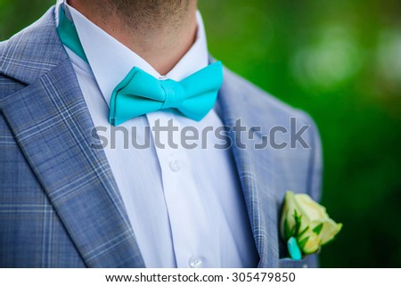 Close-up of a man in a mint-colored butterfly - stock photo