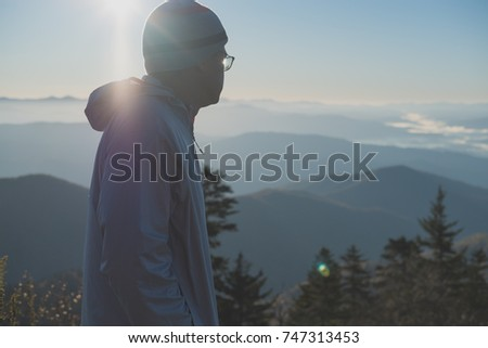 Sunrise Behind The Mountains Stock Images RoyaltyFree Images - This man hikes up the transylvanian mountains every morning to photograph sunrise