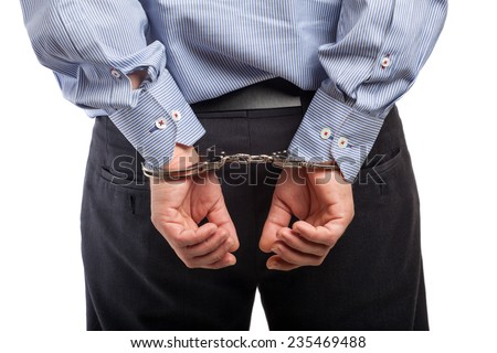 Close up of a man in handcuffs arrested, isolated on white - stock photo