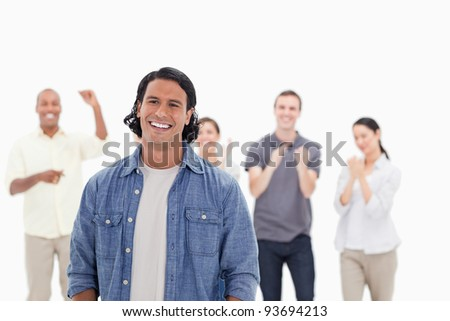 Close-up of a man laughing with people applauding in background - stock photo