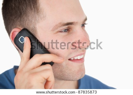 Close up of a man on the phone against a white background