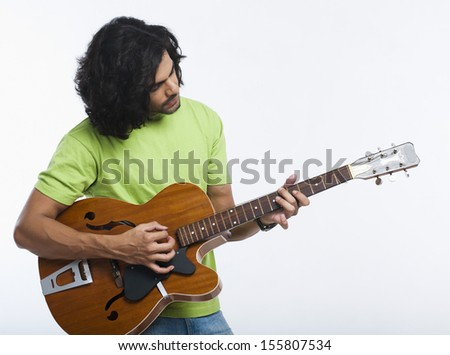 Close-up of a man playing a guitar