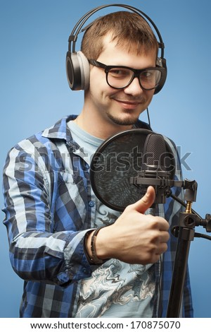 Close-up of a man recording vocals - stock photo