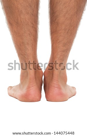 Close up of a man's feet from behind - stock photo