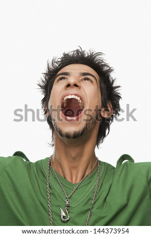 Close-up of a man shouting - stock photo