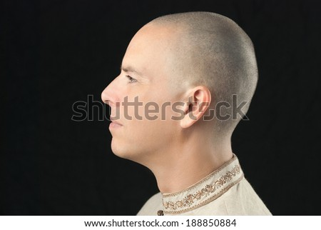 Close-up of a man, side view. - stock photo