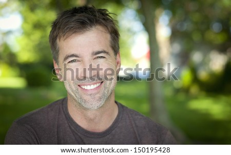 Close-up of a man smiling - stock photo