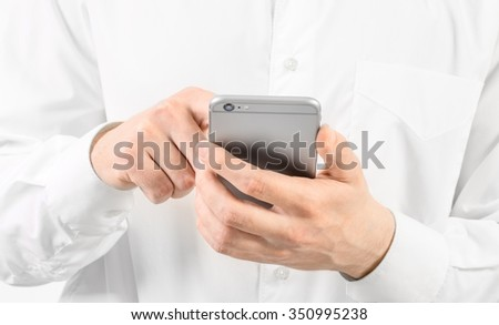 Close-up of a man using mobile smart phone - stock photo