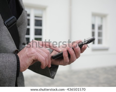 Close up of a man using mobile smart phone - stock photo
