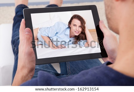 Close-up Of A Man Video Chatting With Young Woman - stock photo