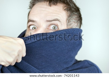 Close-up of a man wearing a housecoat being pulled off camera. - stock photo
