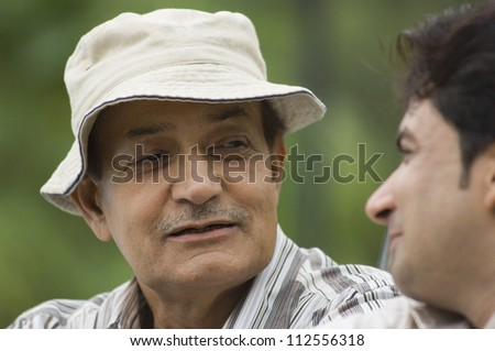 Close-up of a man with his father in a park