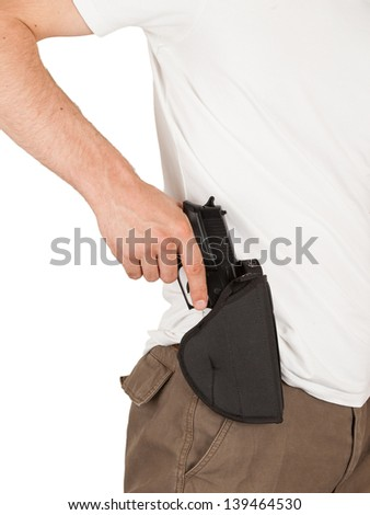Close-up of a man with his hand on a gun, isolated on white - stock photo