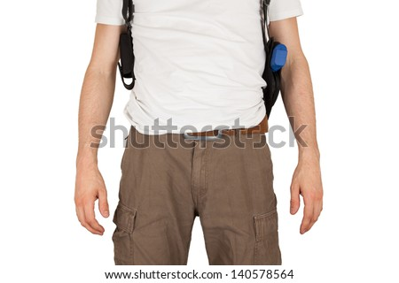 Close-up of a man with holster and a blue training gun, isolated on white - stock photo