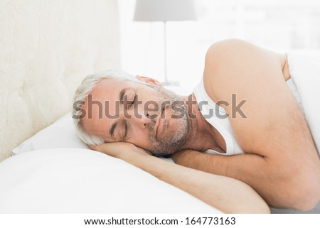 Close-up of a mature man sleeping in bed at home