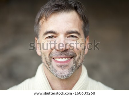 Close-up of a mature man smiling - stock photo