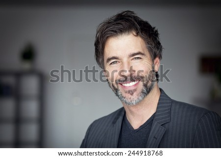 Close Up Of A Mature Man Smiling At The Camera - stock photo
