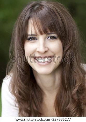 Close-up Of A Mature Woman Smiling At The Camera