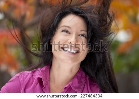 Close-up  Of A Mature Women Cheerful Enjoying The Peace And Love - stock photo