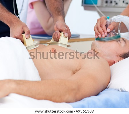 Close-up of a medical team resuscitating a patient at the hospital - stock photo