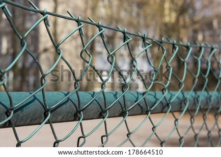 Close-up of a metal grid fence