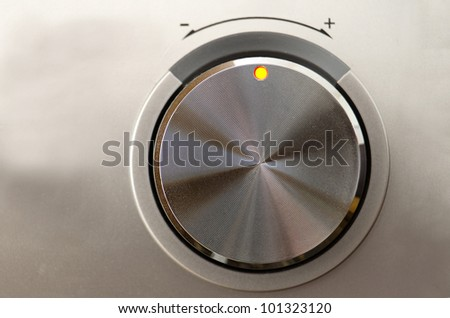 Close up of a metallic volume knob - stock photo