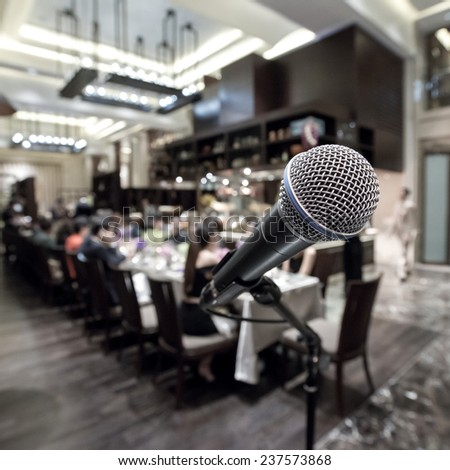 Close-Up of a Microphone in fine dining room - stock photo