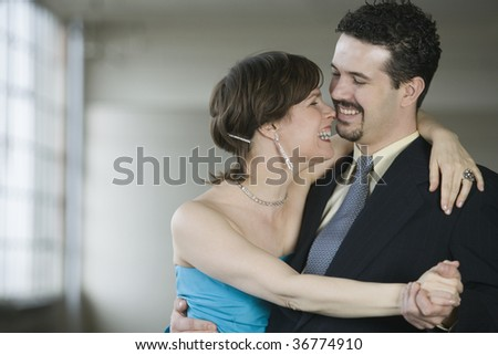 Close-up of a mid adult couple dancing - stock photo