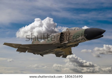 Close up of a military jet with camouflage paint - stock photo