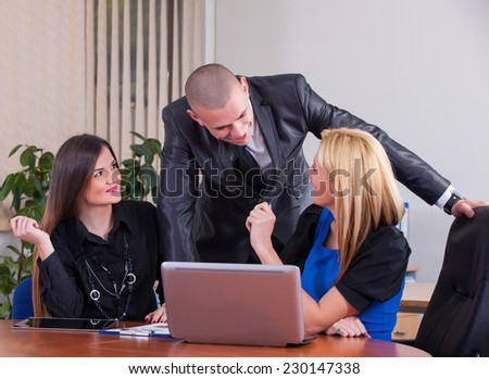 Close-up of a modern business team using tablet computer to work with financial data in office - stock photo