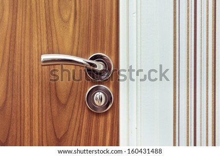 Close up of a modern chrome door handle