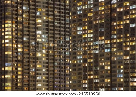 Close - up of a modern high condominium at night time - stock photo